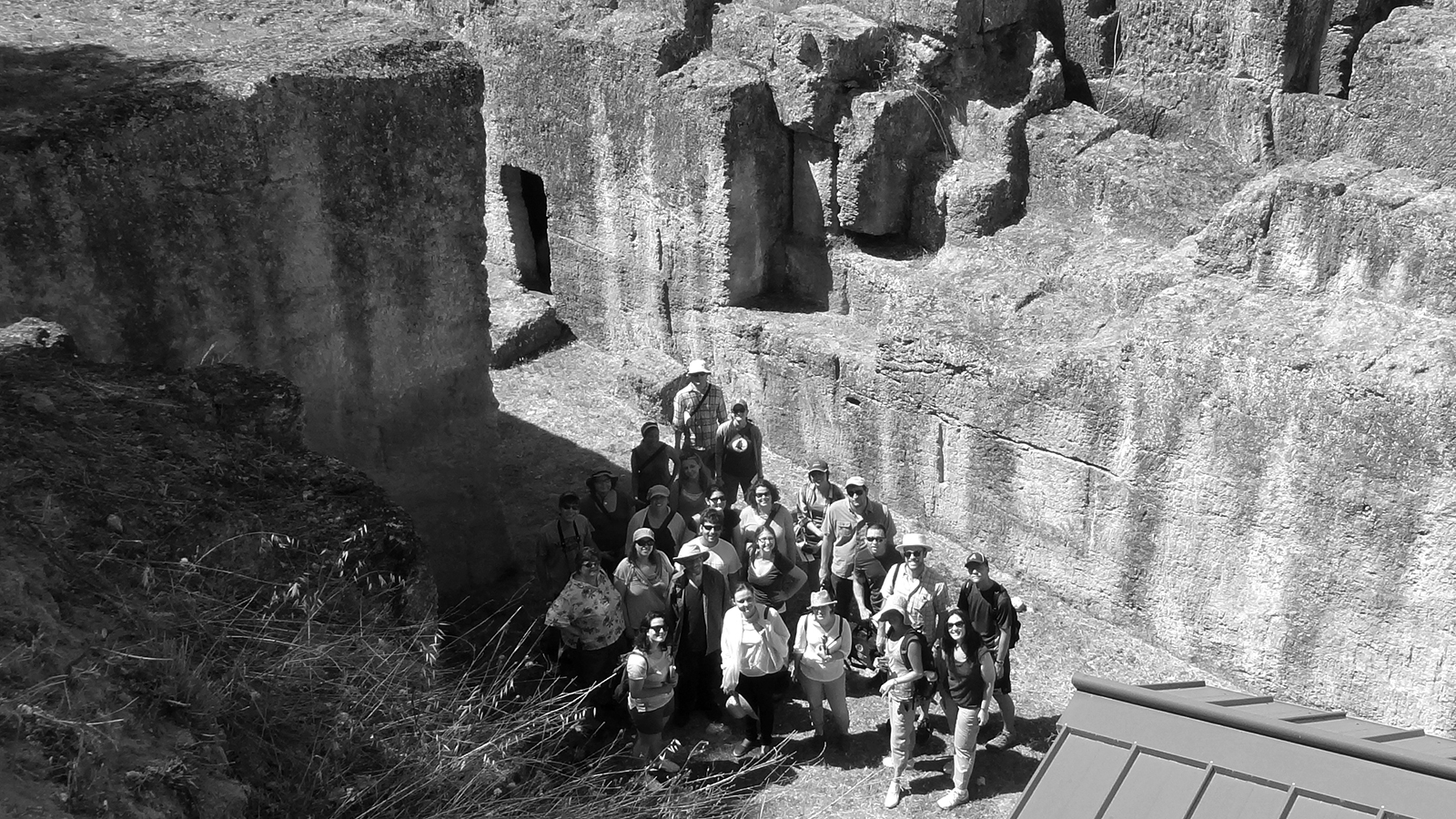 Black and white photograph of 2012 Classical Summer School participants at the Tomba degli Aninas at Tarquinia